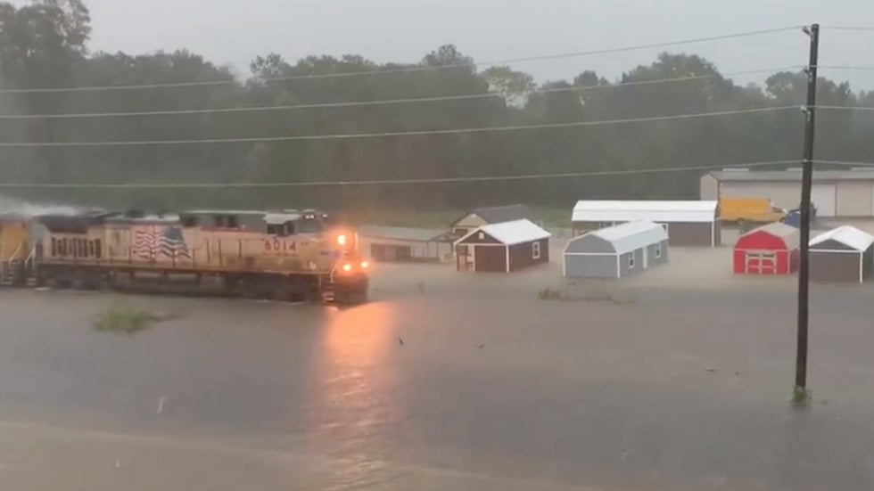 train slows to a crawl in texas floodwaters