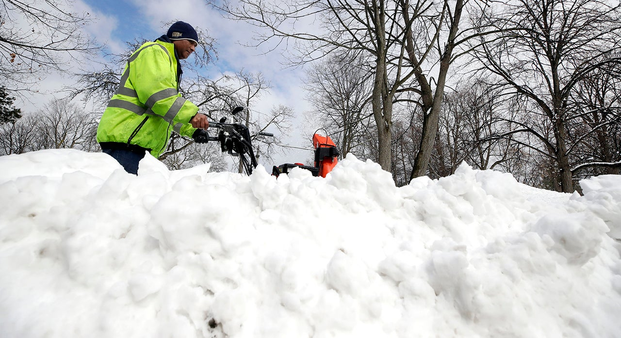 northeast hit by winter storm scott  5 injured after plane skids off maine airport runway