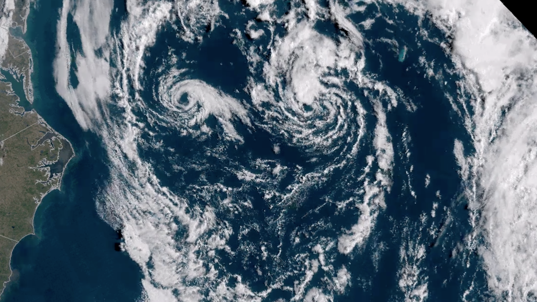 Twin Lows Do a Fujiwhara Dance Off East Coast, Resembling a Face in Satellite Imagery