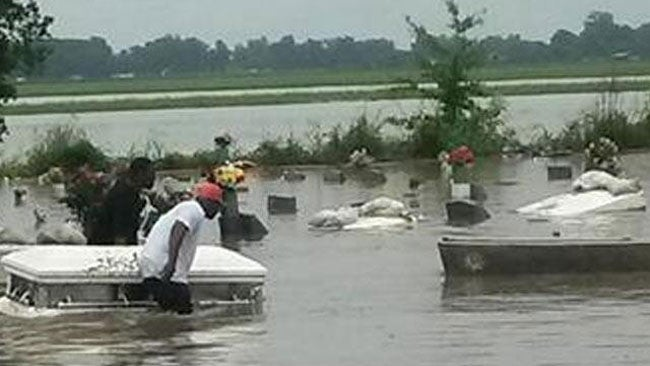louisiana  texas flooding  caskets wash away  man drowns
