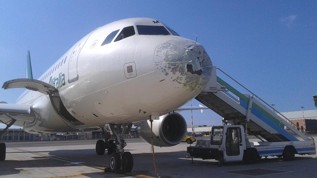 alitalia aircraft punctured by hail made emergency landing