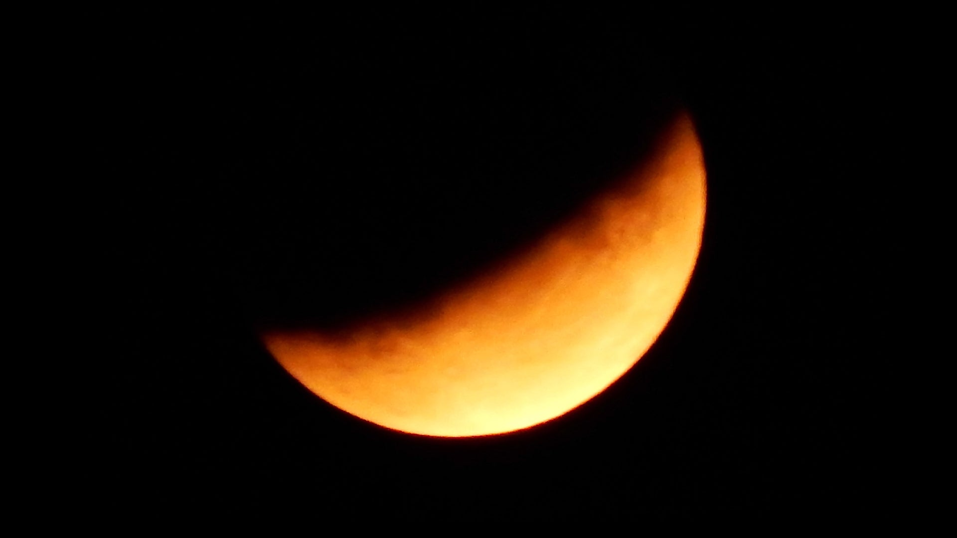 """A stunning """"half blood moon"""" lights up the sky in the United Kingdom during a partial lunar eclipse on July 16."""