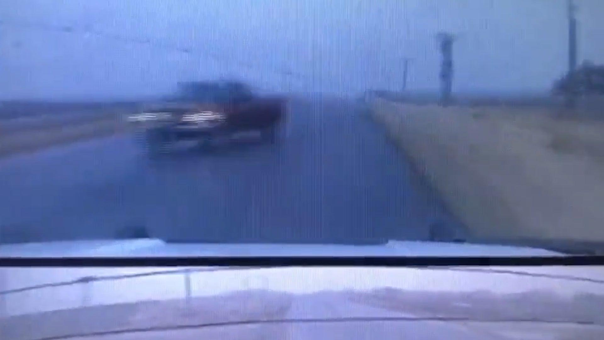 Kansas State Trooper Narrowly Avoids Collision on Rainy Road
