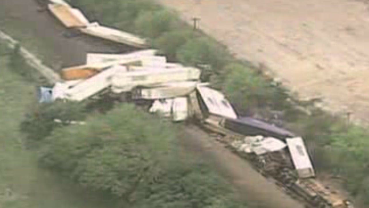 floodwaters  strong winds derail north texas train  injure