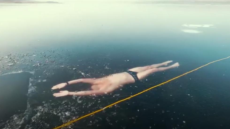 Watch: Free Diver Takes Freakishly Beautiful Swim in Frozen Czech Lake