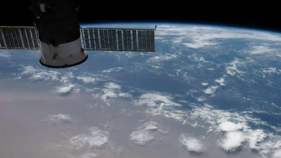 ISS Soars Over Solar Eclipse and Saharan Dust on Summer Solstice