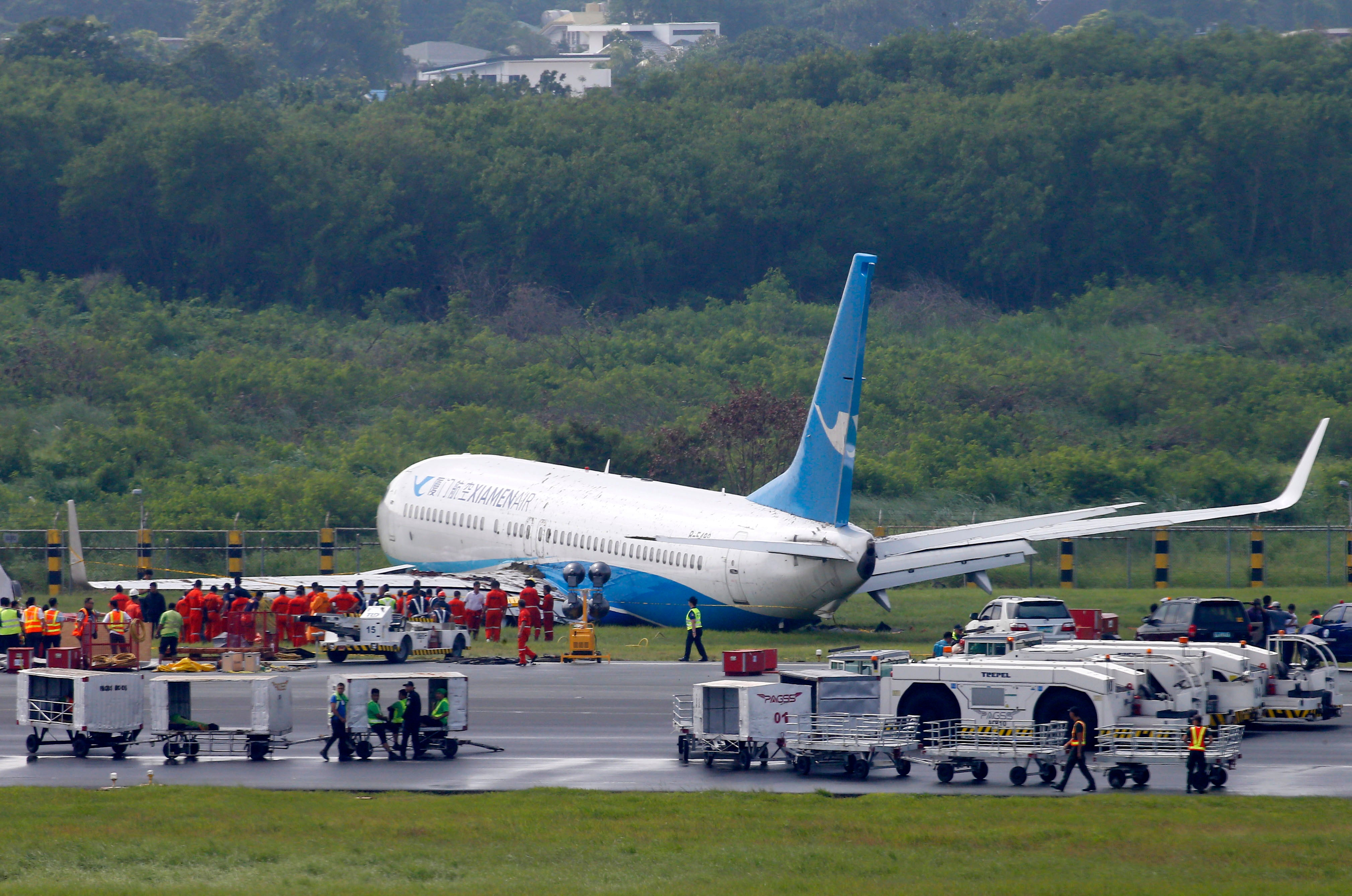 Plane Skids Off Manila Runway in Downpour; All Passengers Safe