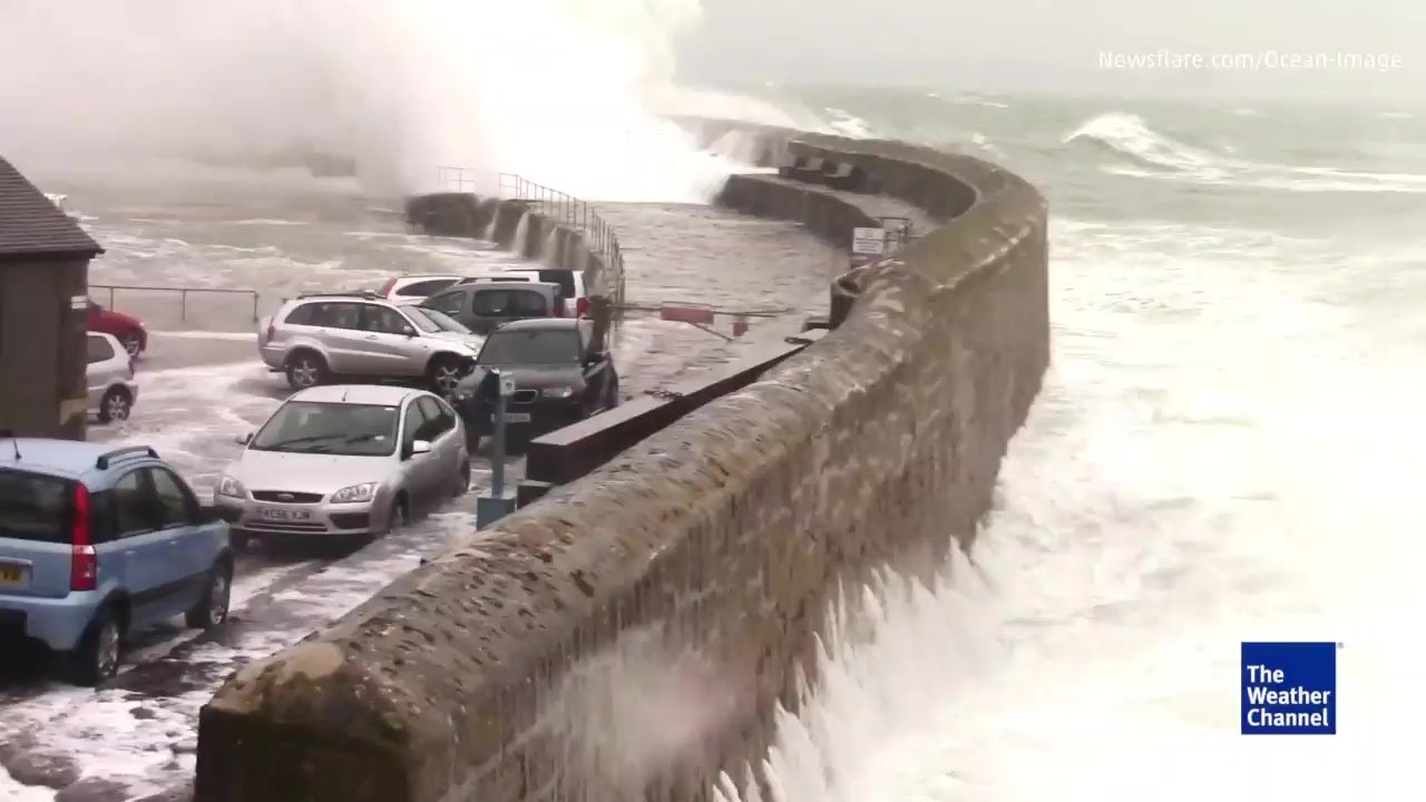 Huge Waves in Cornwall Smash Cars Along the Water