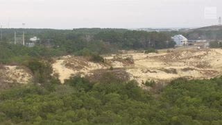 North Carolina's Outer Banks Homes Threatened by Shifting Sand Dune