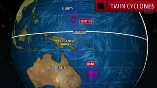 Twin Cyclones in the Western Pacific Spinning in Opposite Directions