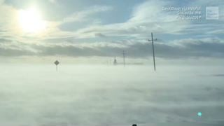 "Woman Ventures Out During Blizzard, Roads Look Like ""Clouds"""