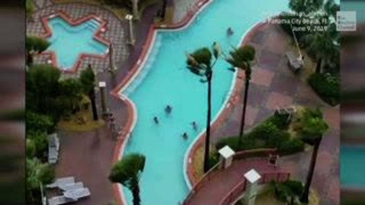 Winds Whip Up Waterspout On Pool