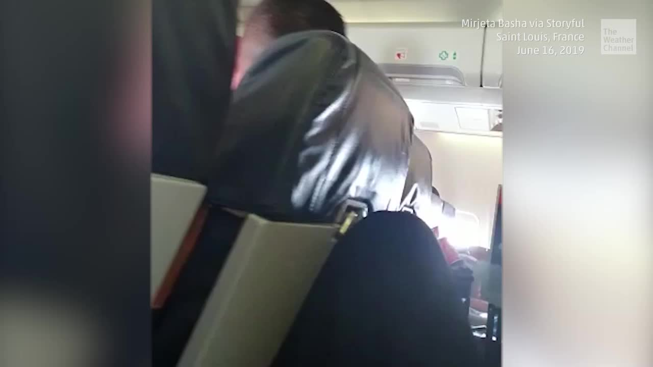 A flight attendant crashes into the ceiling when a plane hits serious turbulence. At least ten people were hurt