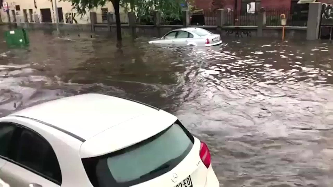 Bus Pushes by Floating Cars in Flood