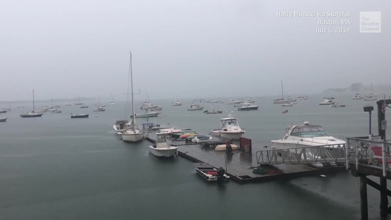 A camera captures the dramatic moment lightning strikes the mast of a moored boat in Boston Harbor.