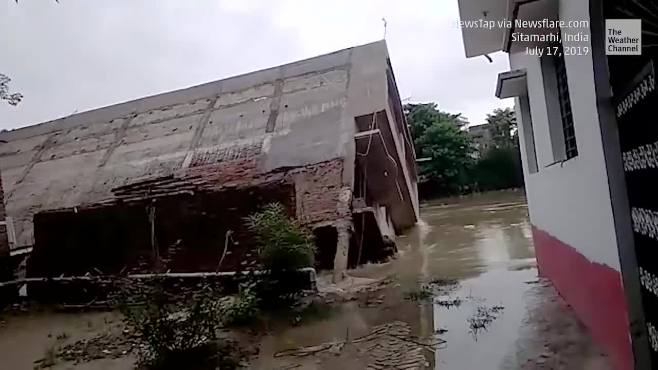 India Floodwaters Topple Home