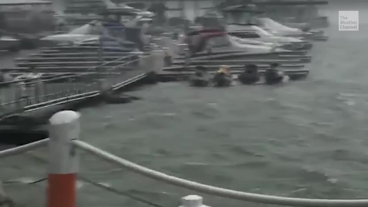 Storm Rips Away Dock on Iowa Lake, People Tossed into Water