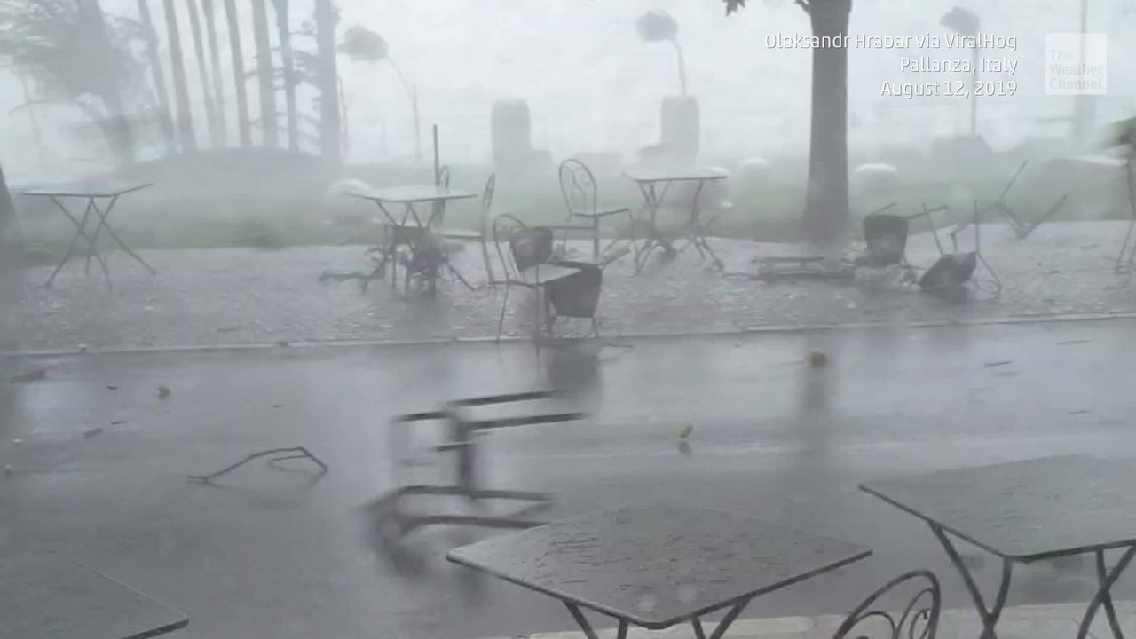 Intense straight-line winds from severe storms sent patio furniture flying in Pallanza, Italy.