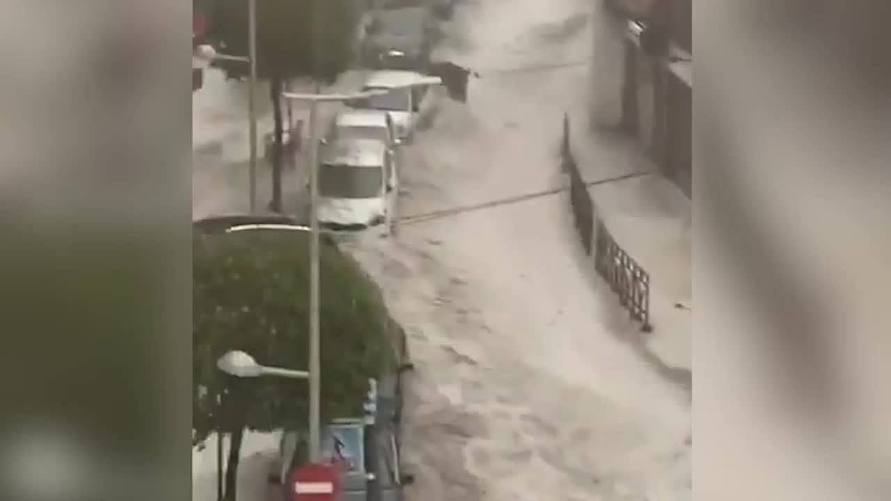 Hailstorm Slams Madrid, Parked Cars Carried Down Roads