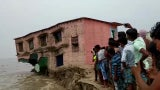 Abandoned School Building Collapses into River in Northeast India