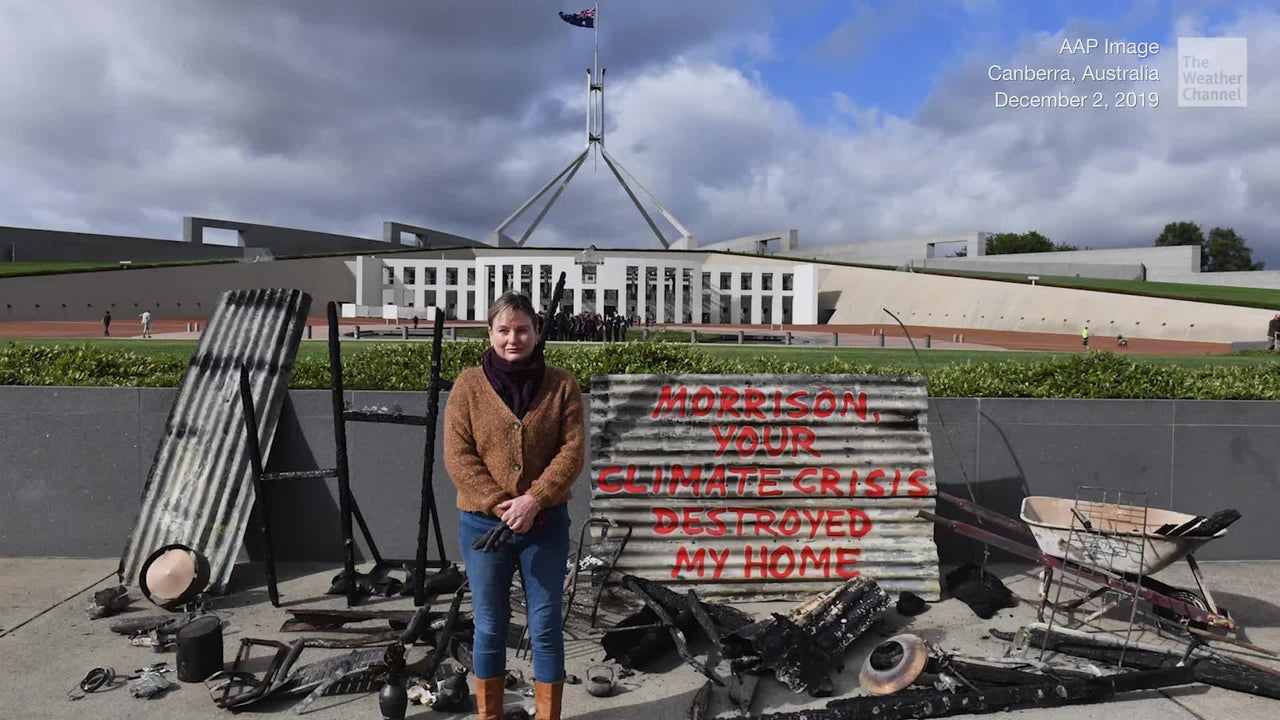 A woman in Australia brings the charred remains of her home to Parliament to protest climate change.