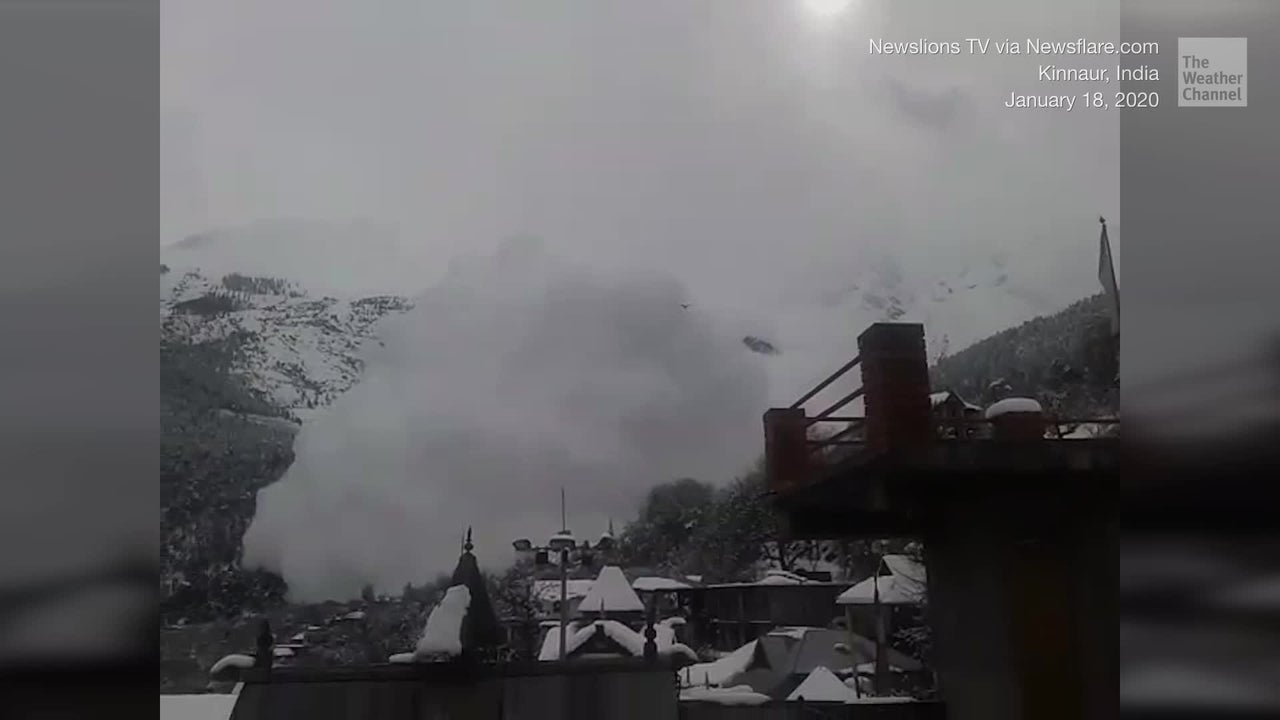 An avalanche comes crashing down near a mountainside village in the northern Indian state of Himachal Pradesh. No injuries were reported.