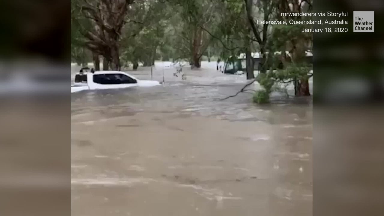 Torrential rain wreaks havoc in Queensland, Australia, but the downpour has helped douse fires farther south in New South Wales.