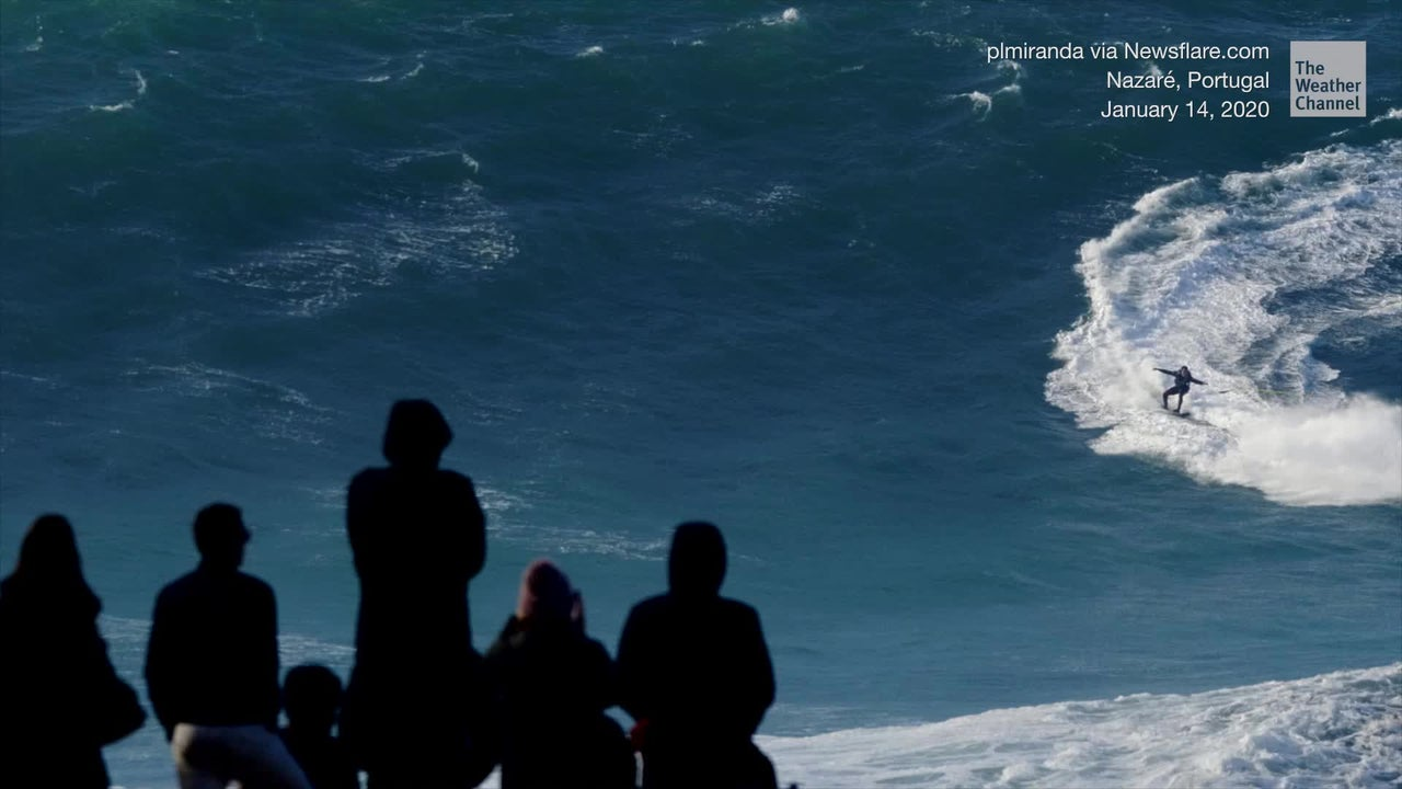 "A wave estimated at 60 feet tall swallowed Brazilian surfer Felipe ""Gordo"" Cesarano at the ""Gigantes de Nazare"" event in Nazare, Portugal. Luckily, he was unharmed."
