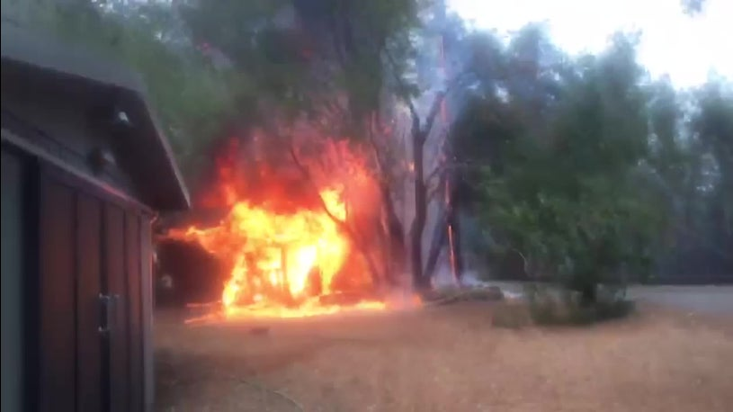 Police Officer Uses Garden Hose to Save Home from Glass Fire