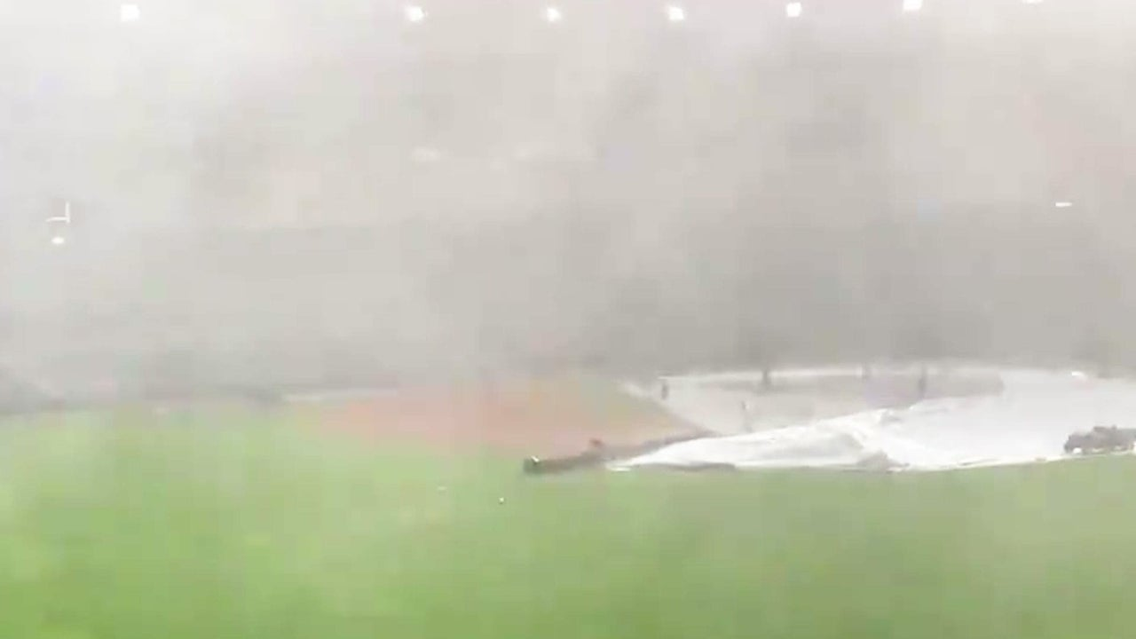 Rain, Wind Thrashes Field Crew Before Yankees-Twins Game