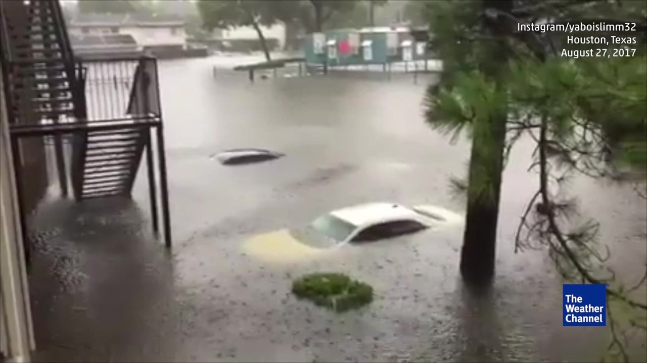 Cars underwater in Houston parking lot