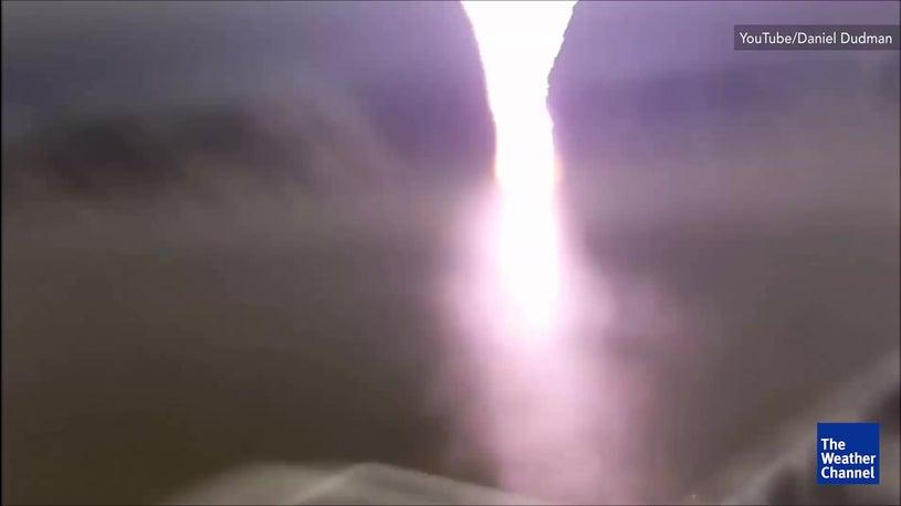 MUST WATCH: men narrowly avoid lightning