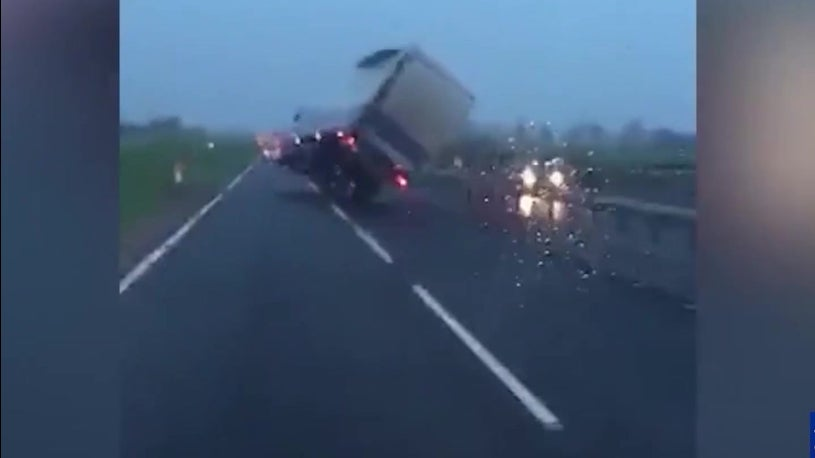 Lorry wheelies down windy dual carriageway