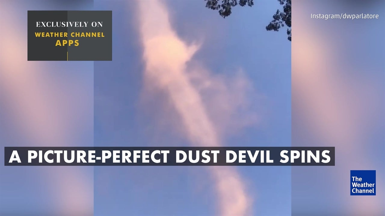 Watch incredible dust devil swirl high in sky
