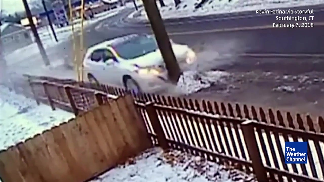 Car crashes into pole on icy road