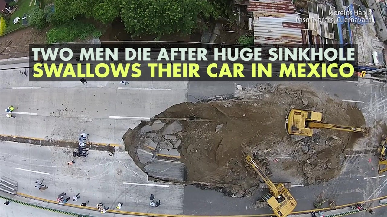Two men killed after driving into sinkhole
