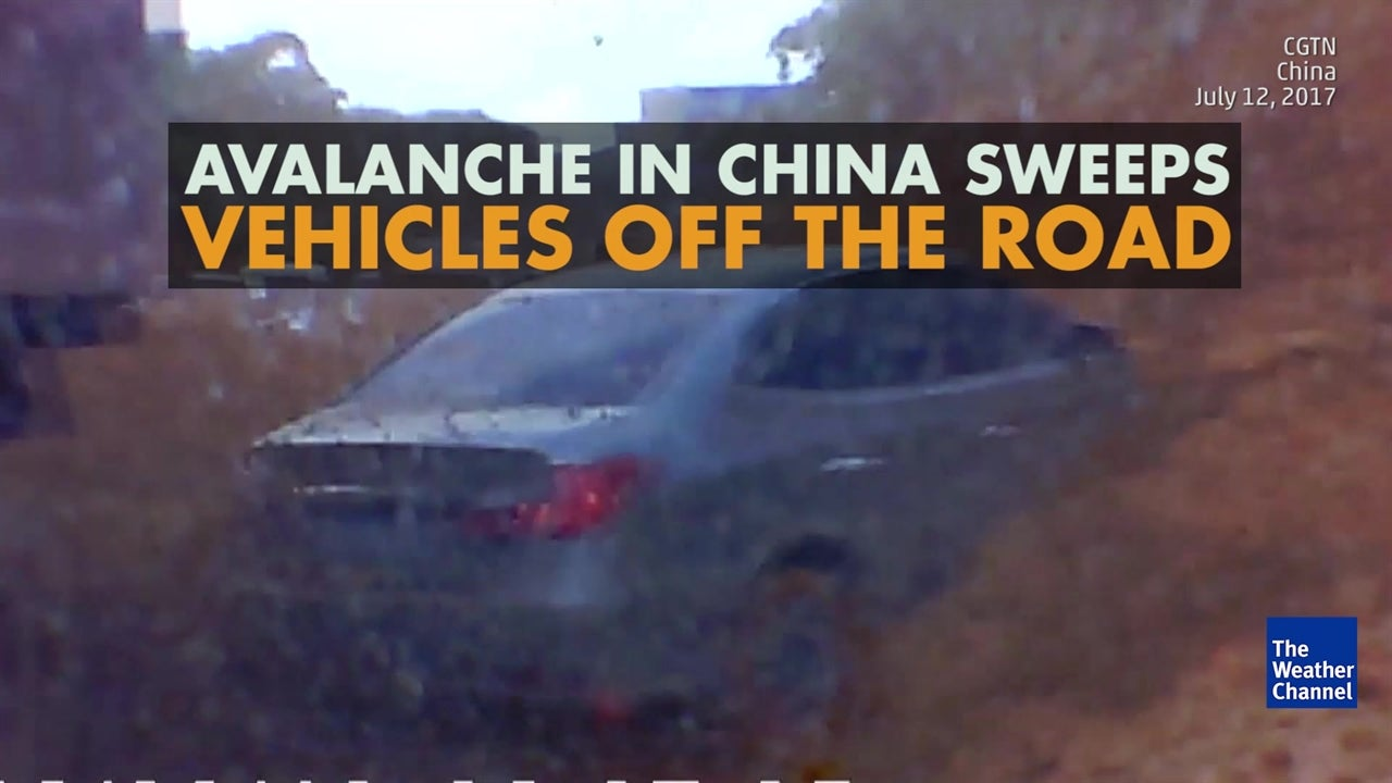Watch: China landslide sweeps vehicles away
