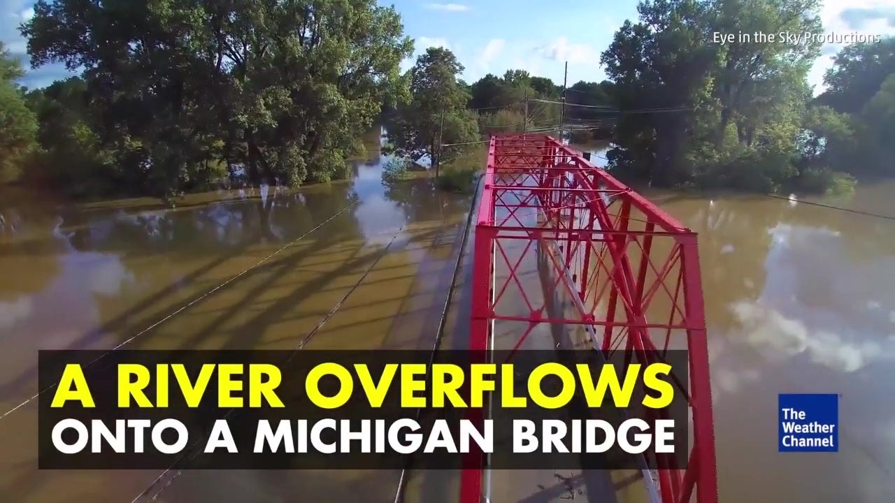 Watch: Massive flooding drowns bridge