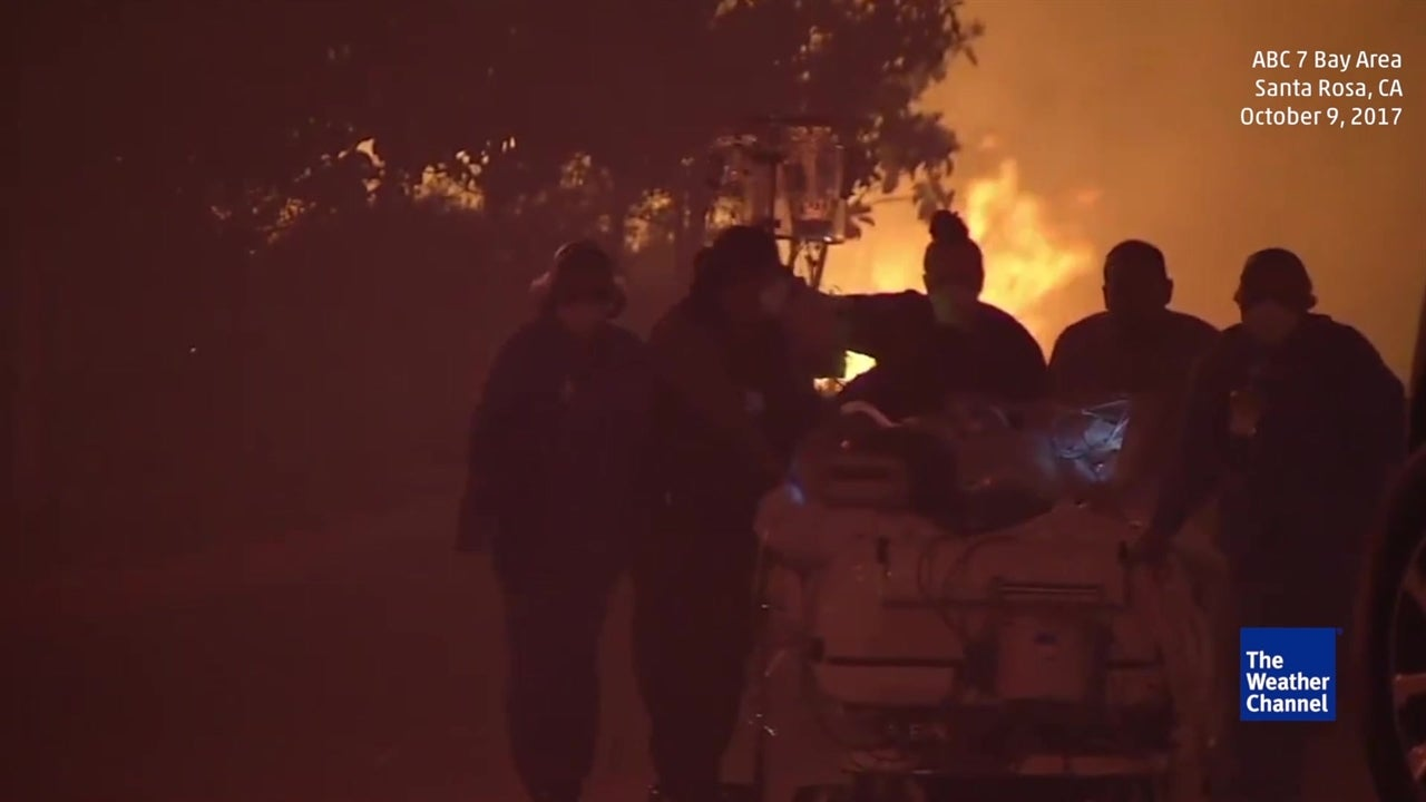 Patients wheeled to safety as fire nears
