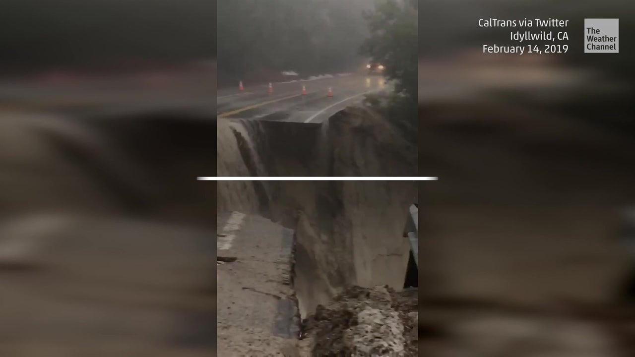 Eroded highway turned  into a raging waterfall
