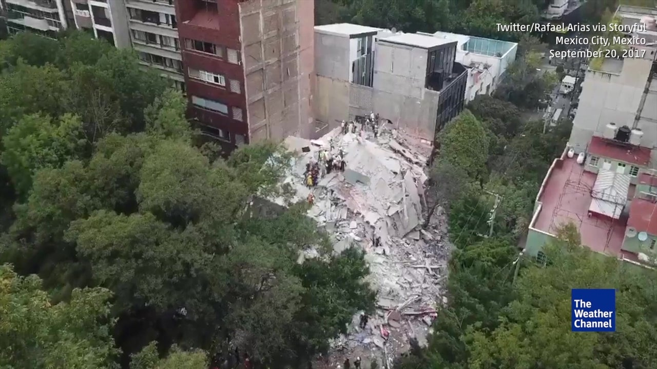 Drone flies over collapsed buildings in Mexico