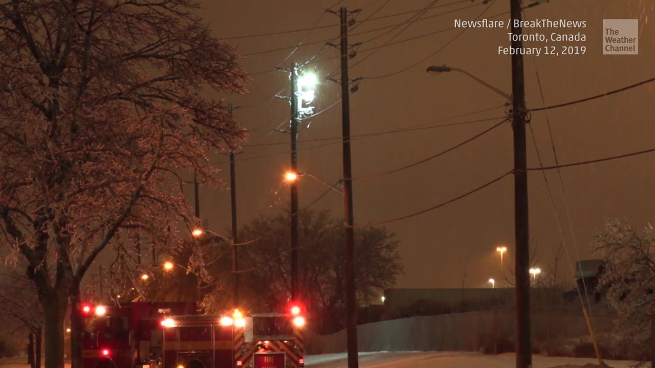 WATCH: Ice storm makes power lines glow