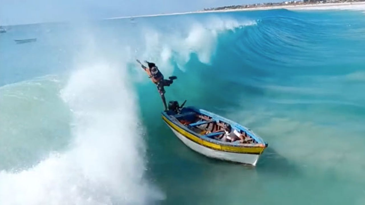 Huge Wave Takes Out Tiny Boat