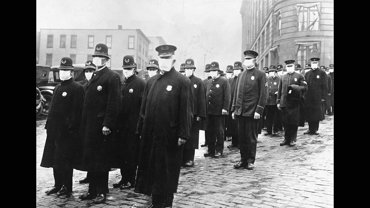 Policemen wear masks provided by the American Red Cross in Seattle as the 1918 flu pandemic takes hold.
