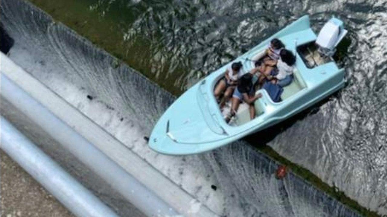 Boat Teeters on the Edge of Texas Dam