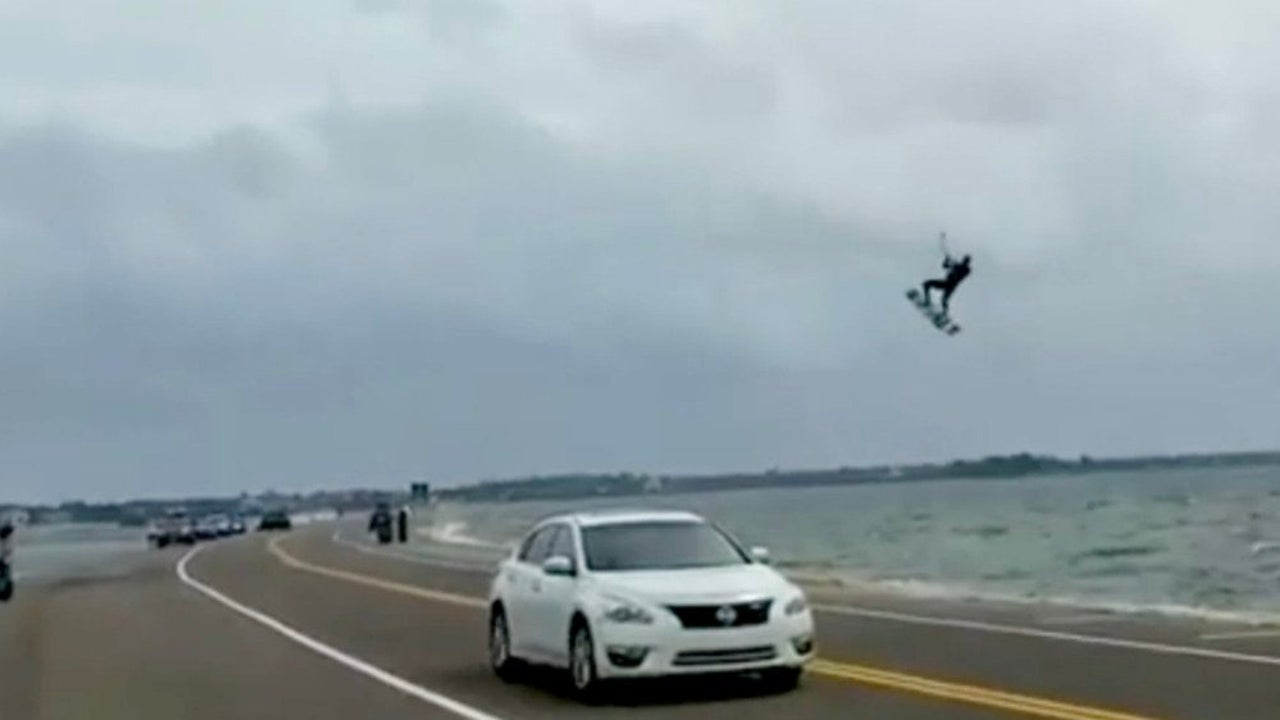 Kiteboarder Goes Airborne Just in Time