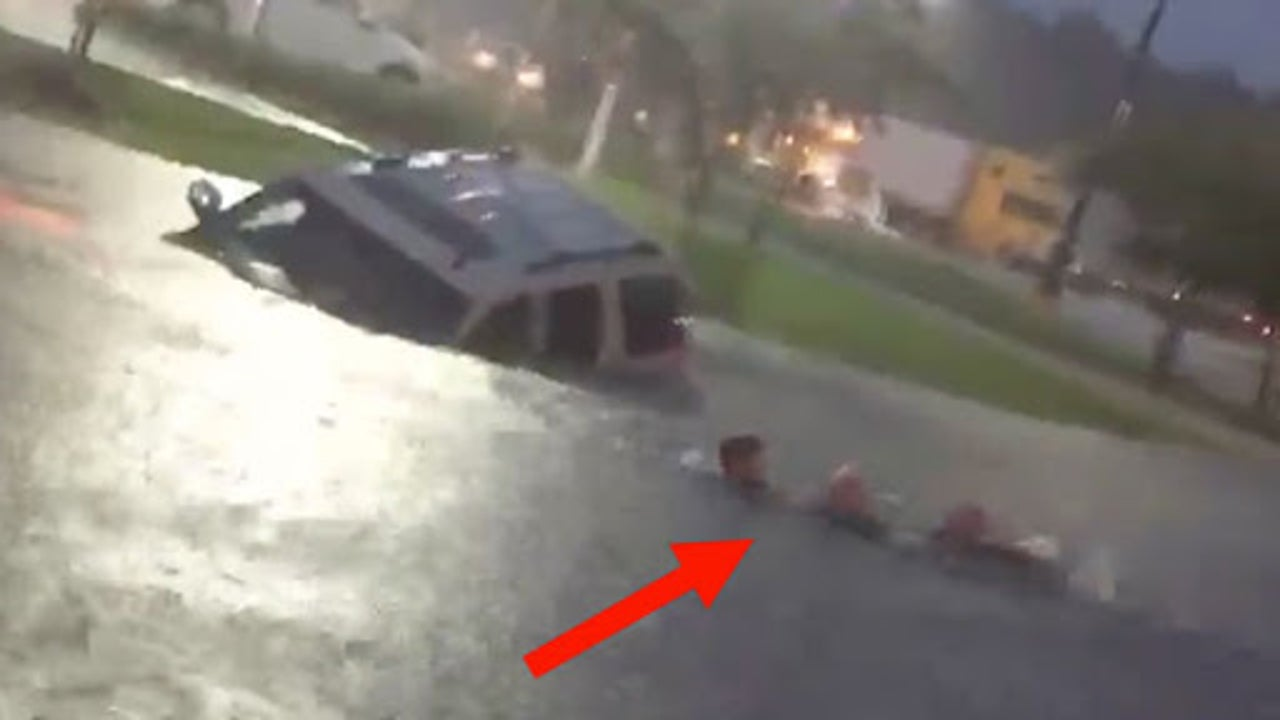 Terrifying Rescue As Floodwaters Devour Car