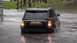 Driver Indecisive About Crossing Flooded Area