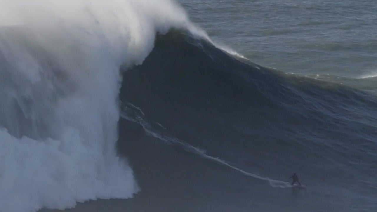 French Surfer Rides Monster Wave in Portugal