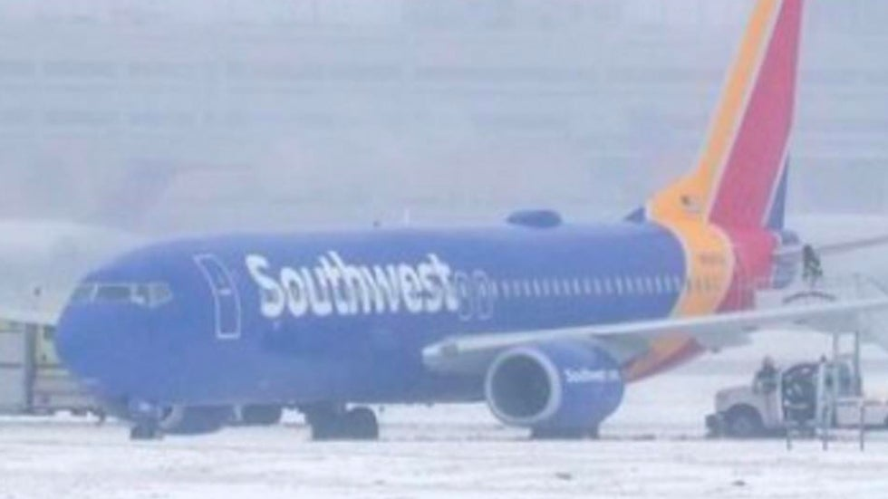 Southwest Plane Slides Off Icy Runway